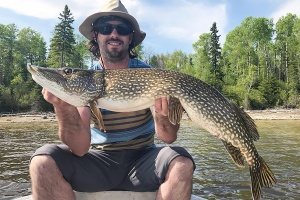 man holding pike