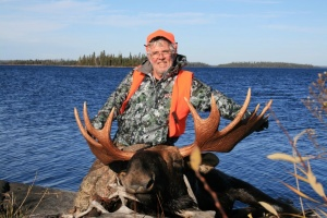 hunter with killed moose