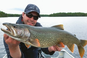 man with caught lake trout