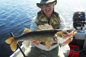 fisherman holding walleye