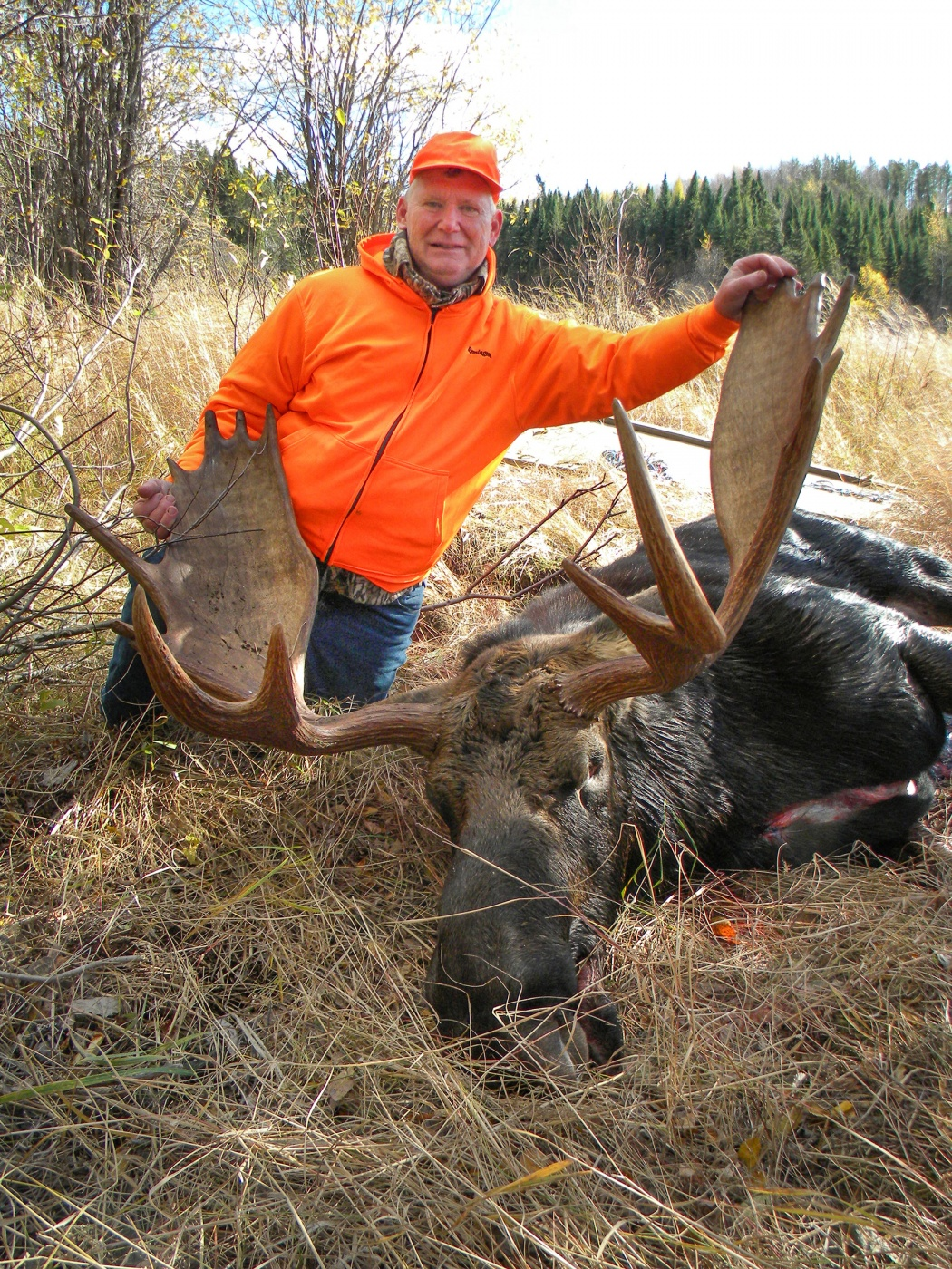 hunter with Canadian moose